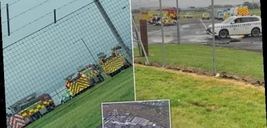 Emergency services rush to aircraft at Glasgow airport