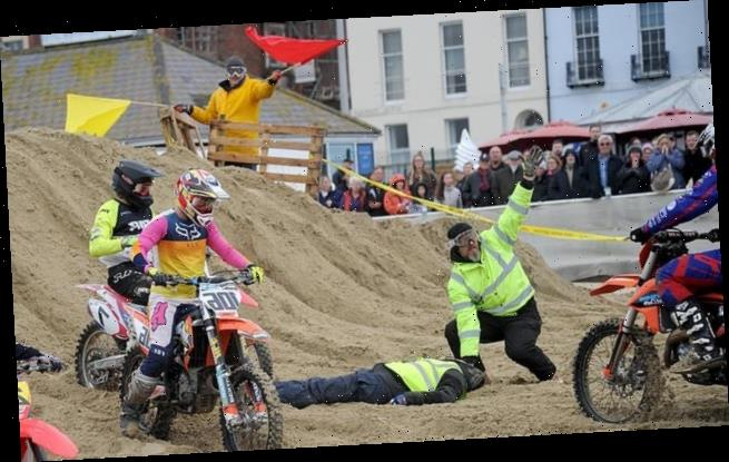 Marshal is seriously injured when a motocross bike landed on him
