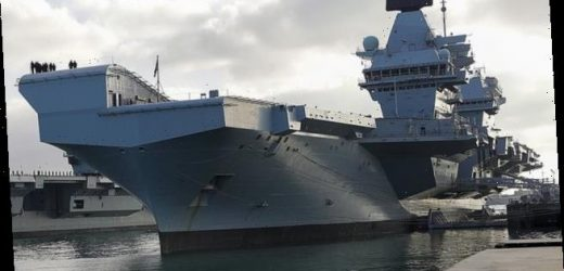 Sailors are forced to abandon aircraft carrier after power cut
