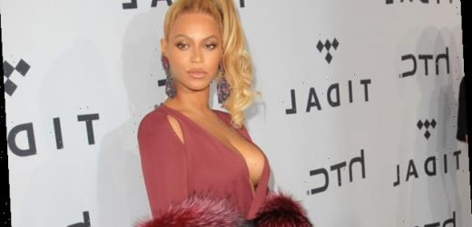 Beyonce Shimmers In A Stunning Red Dress At Clive Davis' Pre-Grammy Party