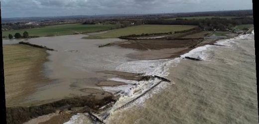 Huge waves smash sea wall as Britain faces more snow and ice