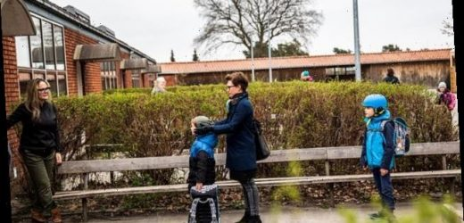 Children line up outside school as Denmark eases Covid-19 restrictions