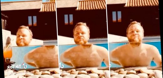 Olly Murs shows off his mansion's luxury swimming pool as he 'loses his head' and sips cocktail in new video – The Sun