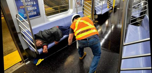 MTA workers cleaning around the homeless on NYC subways