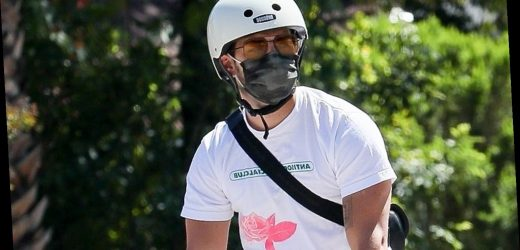Joe Jonas Wears a Face Mask During His Bike Ride