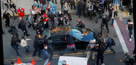 Man with firearm drives into group of protesters in Seattle