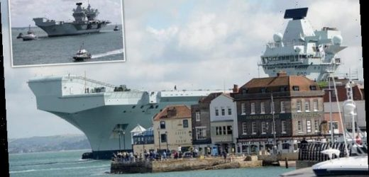 Aircraft carrier HMS Queen Elizabeth returns to Portsmouth