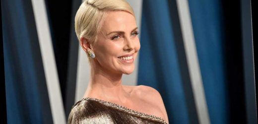 Charlize Theron would love to get her 'ass kicked' in WWE ring