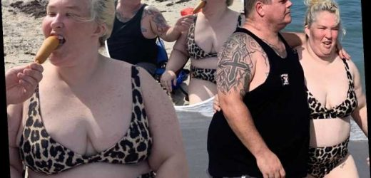 Mama June shows off curves in a skimpy leopard bikini while boyfriend Geno Doak feeds her a corn dog on the beach – The Sun