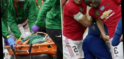 Man Utd's Eric Bailly treated for EIGHT minutes and taken off in neck brace after two worrying head clashes vs Chelsea