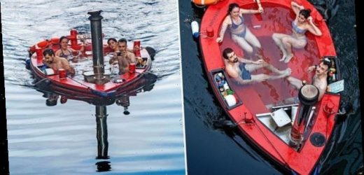 Revellers cruise along the River Thames in a floating HOT TUB