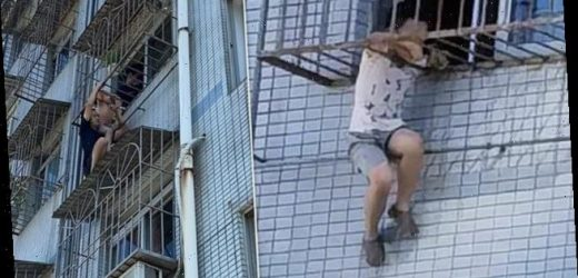 Neighbour supports boy trapped in a window grille with his shoulder