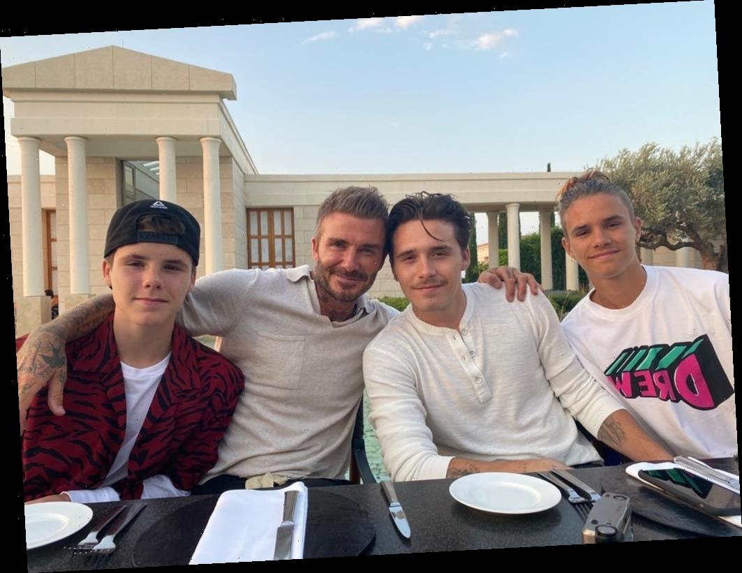 David Beckham proudly wraps his arms around his 'boys' during family holiday meal