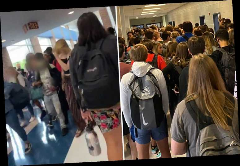 Teens 'SUSPENDED' for posting pics of packed school hallways full of students with no masks