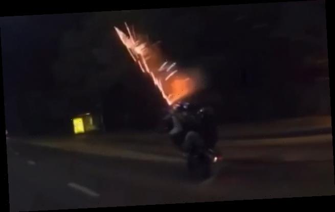 Shocking moment motorcyclist lets off FIREWORKS from his bike