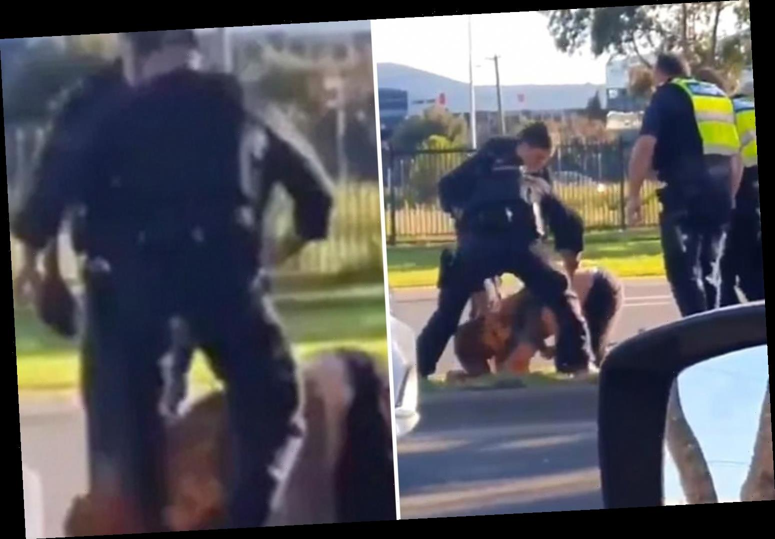 Shocking moment cop stamps on unmasked man's HEAD in front of horrified drivers in lockdown Melbourne
