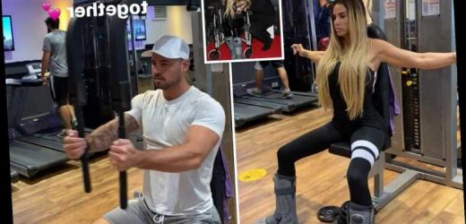 Katie Price hits the gym with broken feet as determined star works out in orthopaedic boots with boyfriend Carl Woods