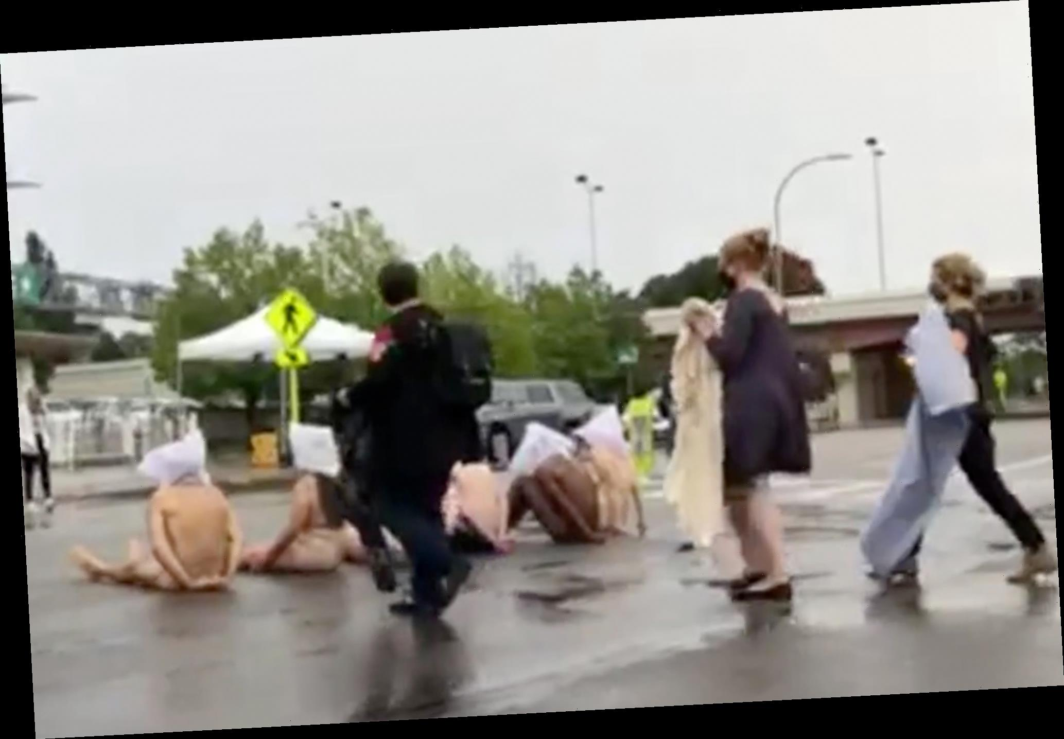 Naked demonstrators in spit hoods show up to Rochester protests over Daniel Prude