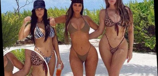 Kim Kardashian accused of photoshop fail as fans spot her arm is 'missing' in bikini picture