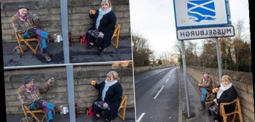 Friends meet up for a cuppa either side of council boundary signs