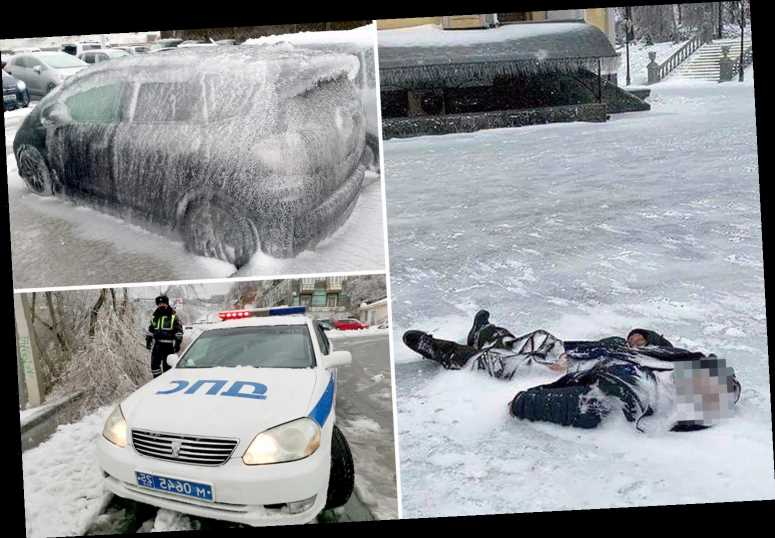 Homeless man found encased in icy tomb just feet from Russian cathedral after getting caught in 'freezing rain' storm
