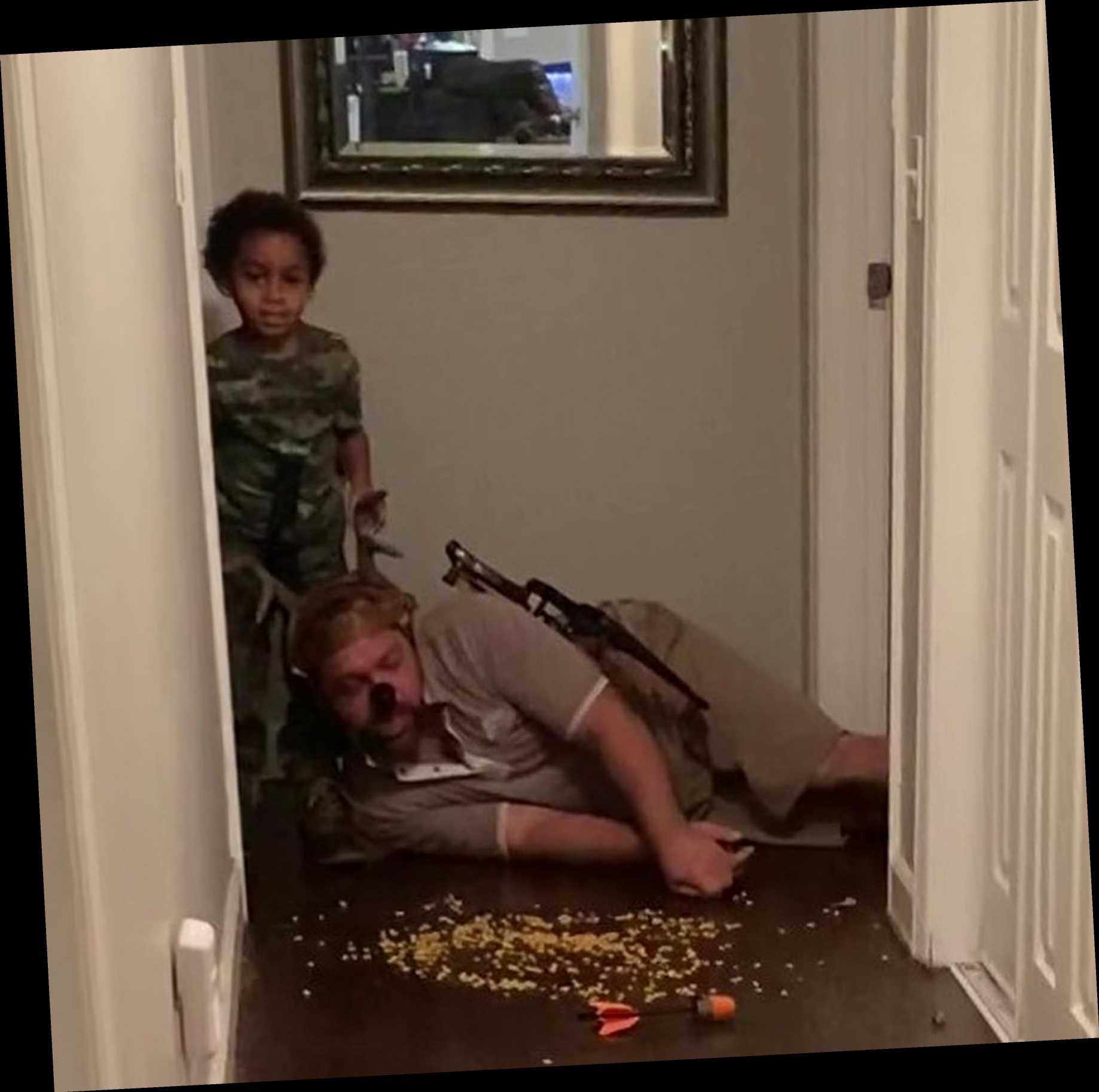 Dad films himself teaching his son, 6, to HUNT by dressing up as a deer and arming his boy with a toy crossbow