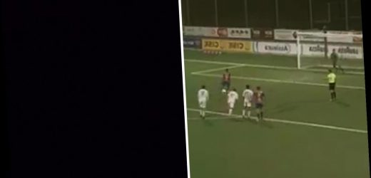Watch 'biggest cliffhanger in football history' as national power cut plunges match into darkness as penalty kick taken