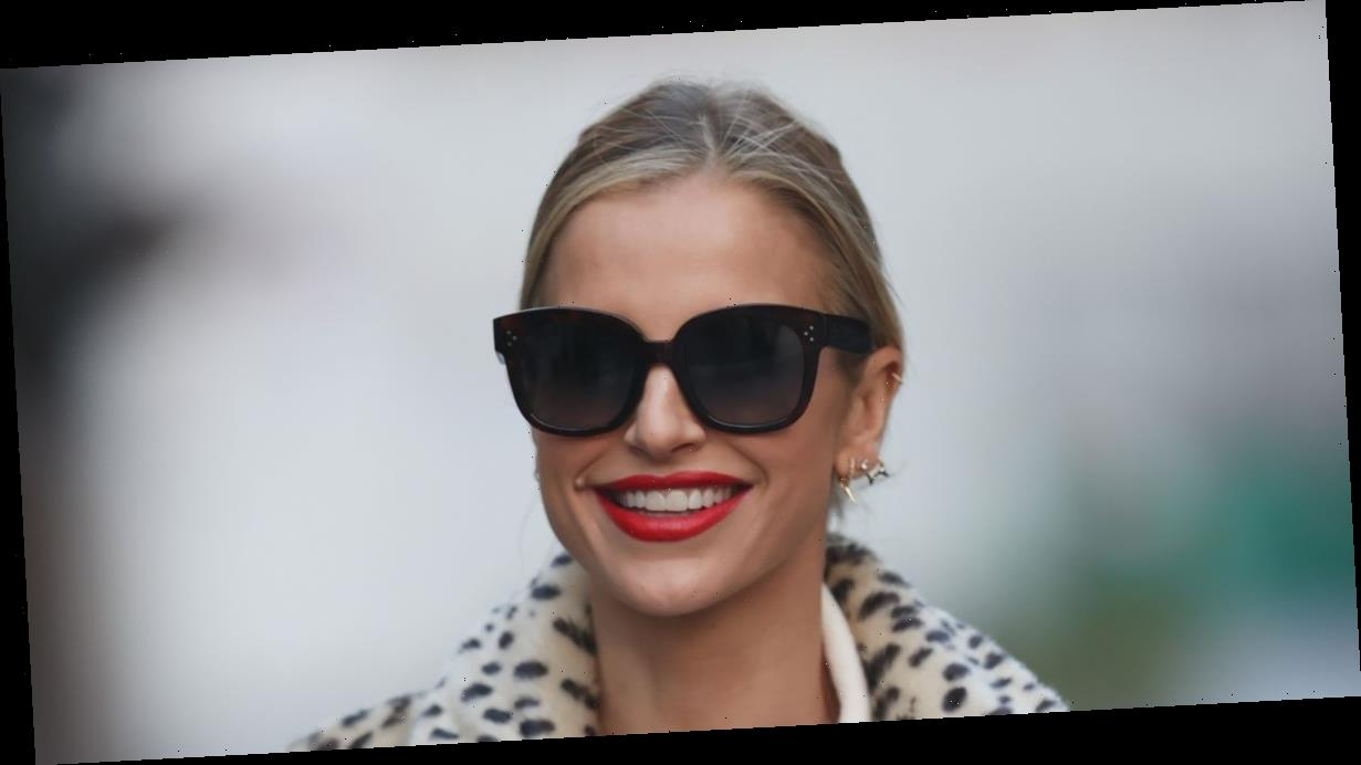 Vogue Williams looks as stylish as ever in leopard print coat and dark shades as she heads home from work