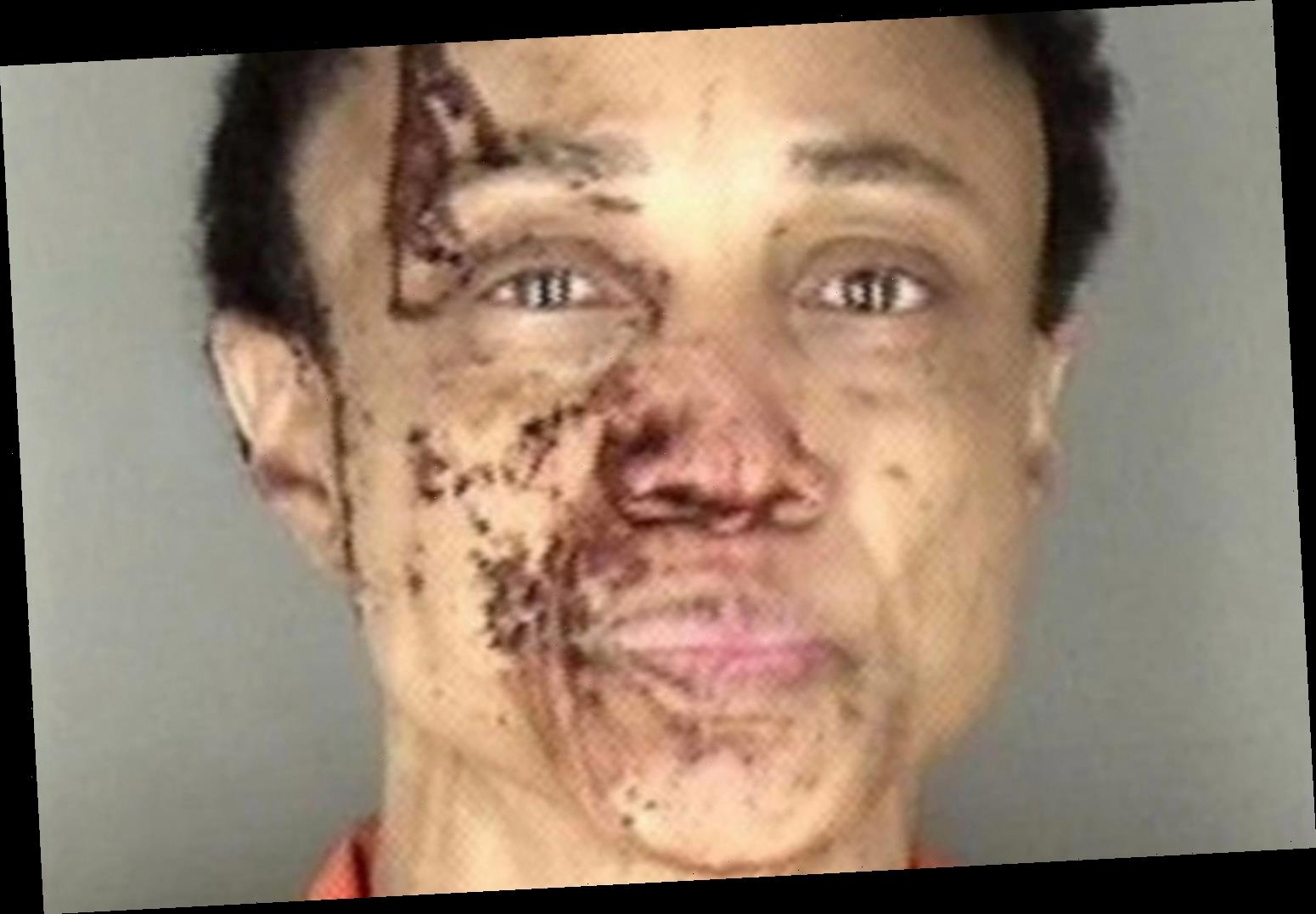 Shock mugshot shows woman covered in blood after 'killing dad, 73, and leaving trail of blood'