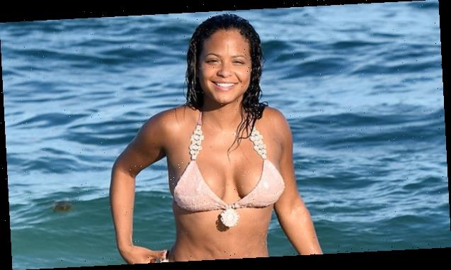 Pregnant Christina Milian Shows Off Her Bare Baby Bump In Tiny Gold Bikini While In The Ocean