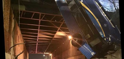 New York City bus crashes through barrier, dangles from overpass; 9 injuries reported