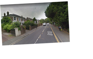Man arrested on suspicion of murder after woman discovered dead at house in Ealing