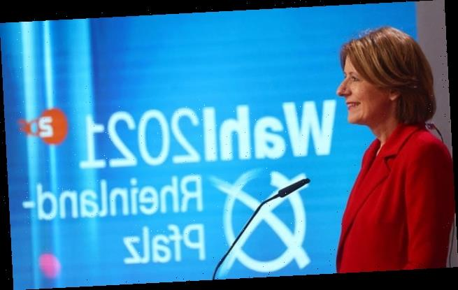 Angela Merkel's CDU hammered in local elections, exit polls suggest