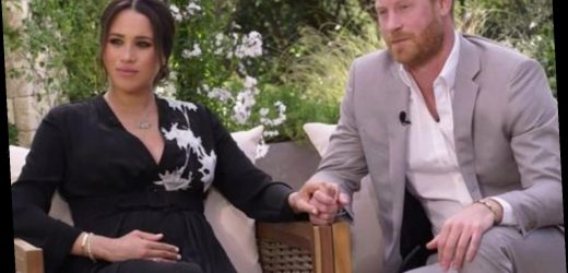 Meghan Markle cradles baby bump during Oprah bombshell after being asked if she was 'silent or silenced'