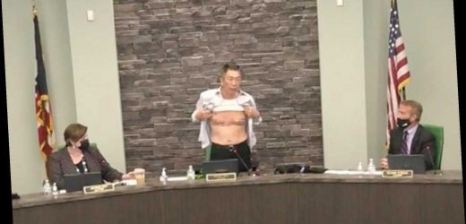Asian American politician removes shirt to show wounds, prove patriotism