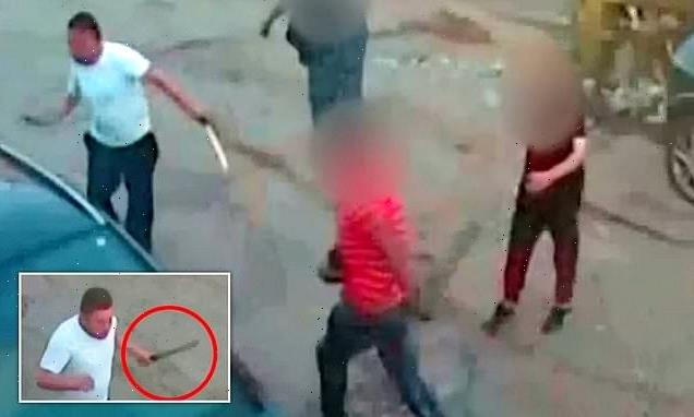 Moment brave have-a-go-hero chases off machete-wielding robber