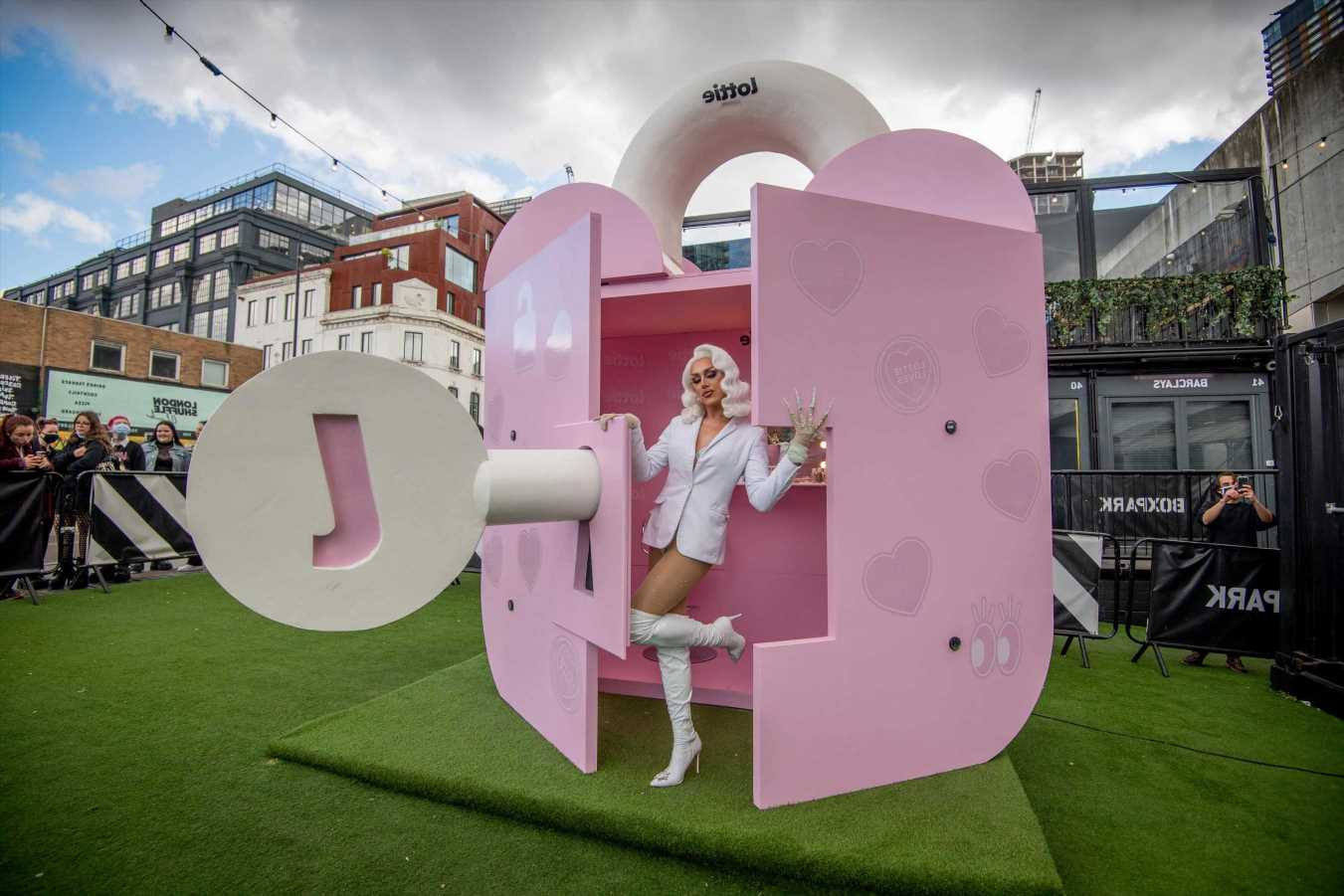 RuPaul's Drag Race star A'Whora bursts out of giant padlock in London to celebrate lockdown easing