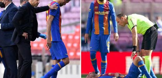 Barcelona star Sergio Busquets taken to hospital for 'further tests' after HORROR head clash with Atletico star Savic