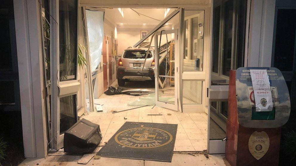 Man arrested after attempting to run over cops, driving car through police station lobby
