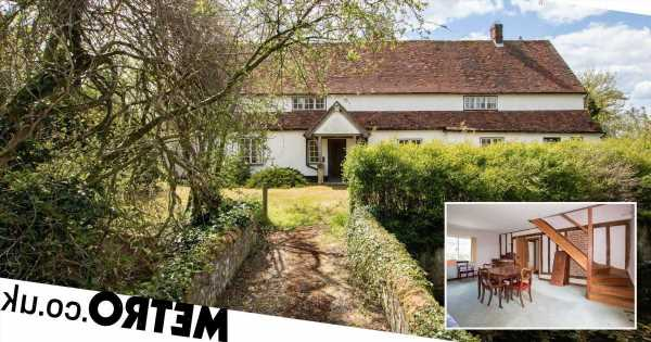 This historic farmhouse with its very own moat is on sale for £600,000