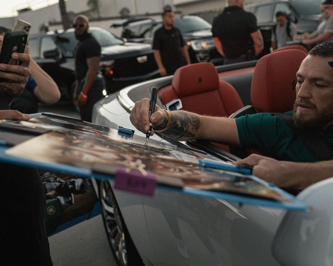 Conor McGregor told to stick to 'no more Mr Nice Guy' vow as he signs autographs for adoring fans ahead of UFC 264