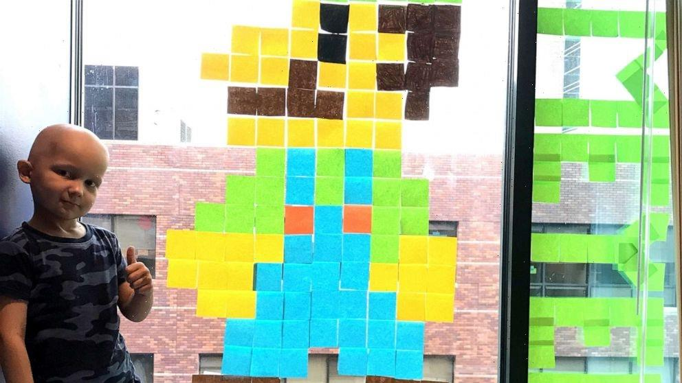 Boy makes friends with hospital staff across street using Post-it notes