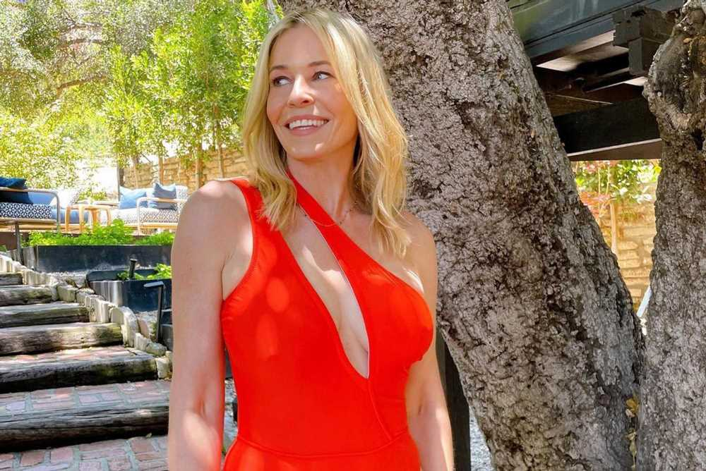 Chelsea Handler sizzles poolside in a red hot swimsuit