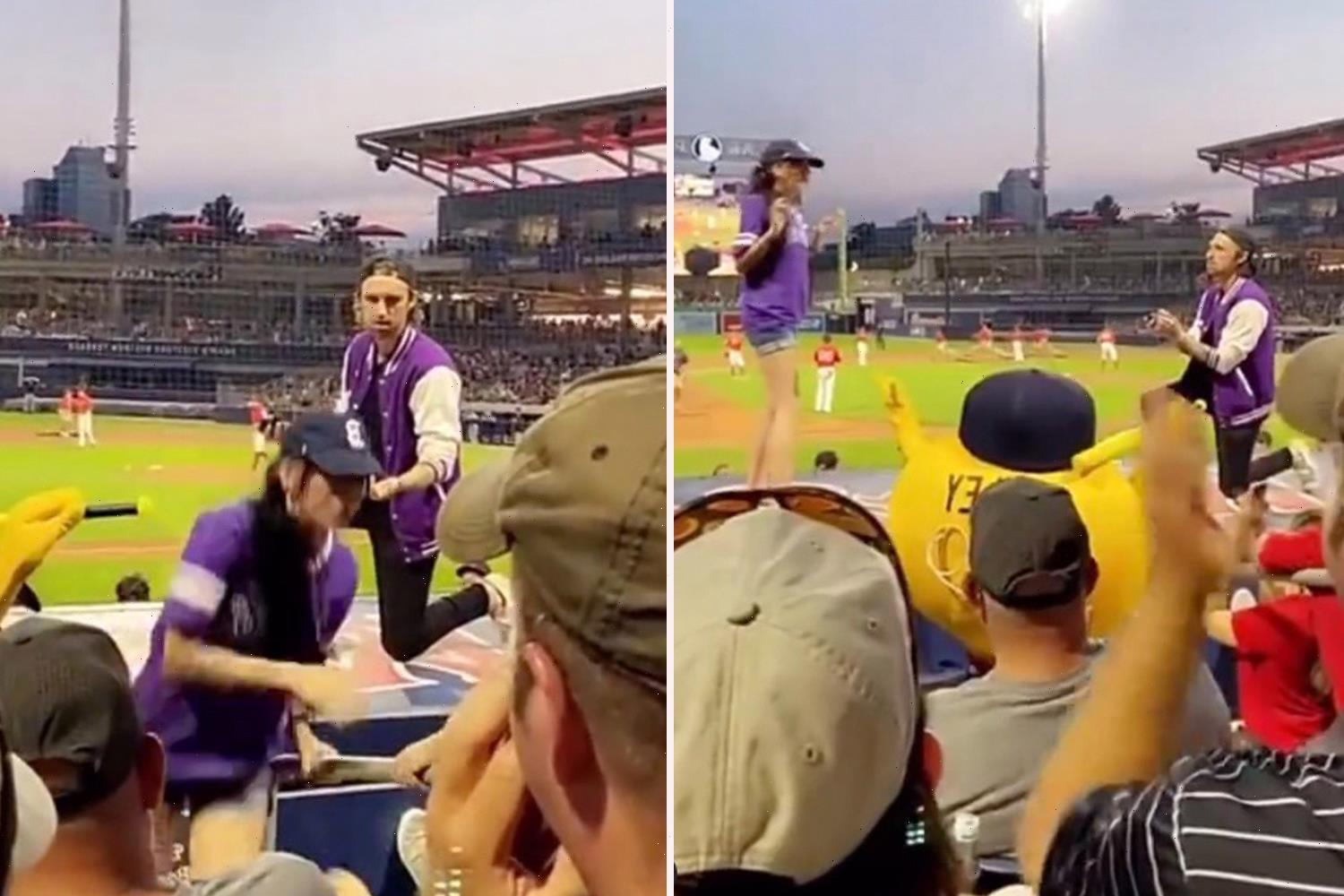 Cringing moment baseball fan's marriage proposal at game goes horribly wrong as girlfriend RUNS away… but is it real?