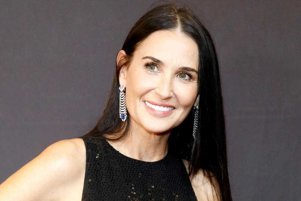 Demi Moore and her three daughters model matching swimsuits