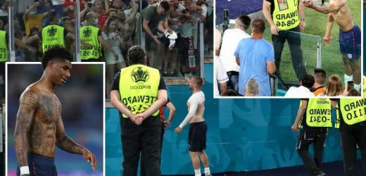 England stars Shaw, Rashford and Bellingham leap over advertising hoardings to give shirts to fans after Ukraine triumph