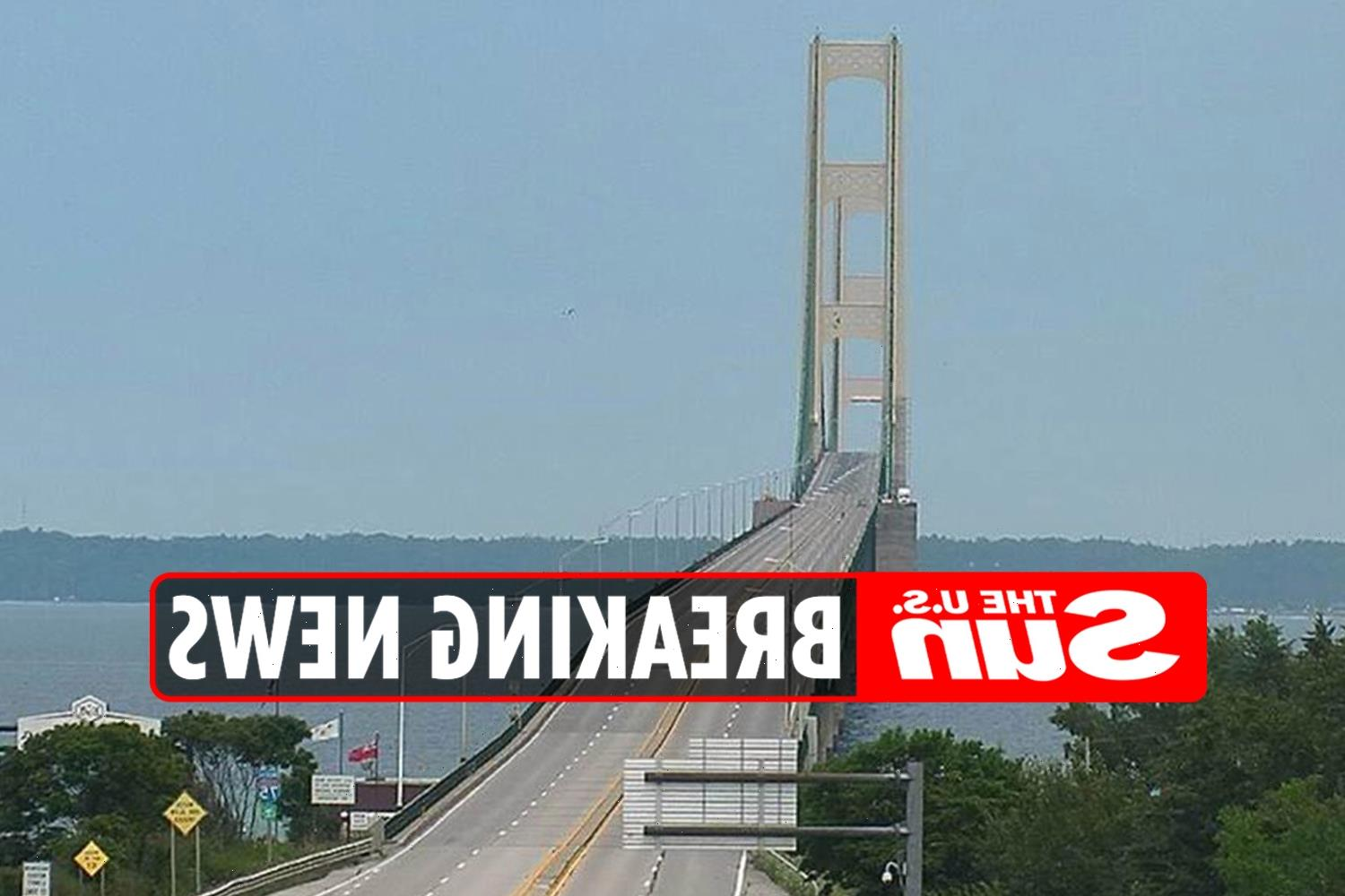 Michigan's Mackinac Bridge is closed after 'emergency incident': Bomb sniffing dogs seen combing area