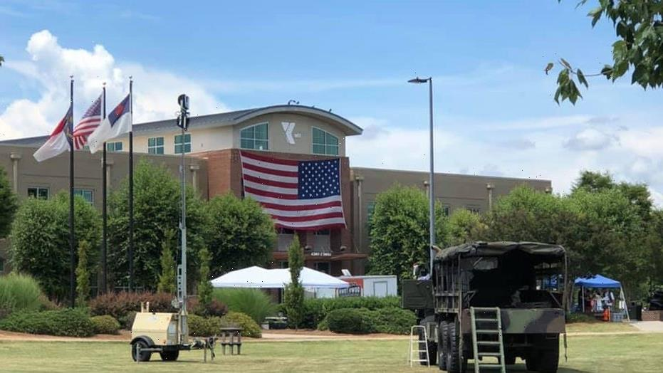 North Carolina Scout troops camp out, watch over American flag display