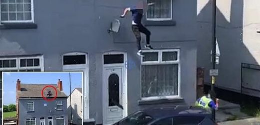 Shocking moment man leaps from roof of two-storey building