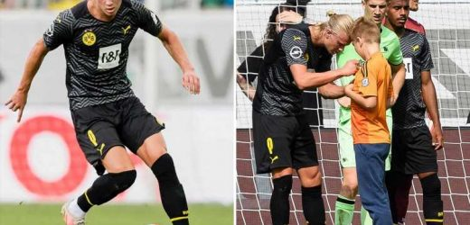 Watch young pitch invader get Erling Haaland's autograph as Chelsea transfer target lines up for Dortmund in pre-season
